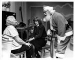 Medniki playing Santa Claus at Our Lady of Lourdes Hospital to patients