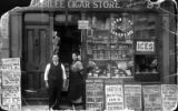 Albert Balno's Aunt and Uncle standing in front of the Jubilee Cigar Store.