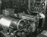 Man operates machinery at the Budd Company plant