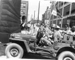 Vehicle with First City Troop members enters armory