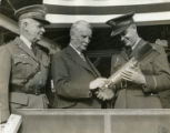 Edward G. Budd shows Army Colonel and Brigadier General the one millionith manufactured...