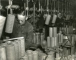 Budd Company employees work on fragmentation bombs