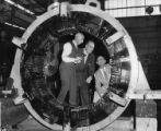 Current and former General Electric employees look at generators during anniversary celebration