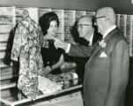 Franklin Simon sales clerk displays piece of clothing