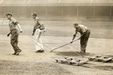 Groundskeepers rake infield of Connie Mack Stadium