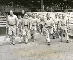 Many groundskeepers walk onto field at Connie Mack Stadium