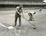 Groundskeepers at Connie Mack Stadium maintain infield