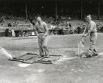 Groundskeepers maintain baselines at Connie Mack Stadium