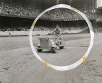 Groundskeeper smooths the dirt on the infield of Connie Mack Stadium