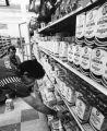 Supermarket employees stock shelves