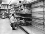 Thomas Gregory stocks shelves at Acme supermarket
