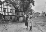 Two women looking at home in Chestnut Hill