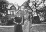 Two women in front of home in Chestnut Hill