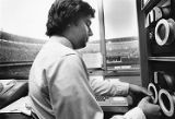 Denny Lehman operates scoreboard at Veterans Stadium