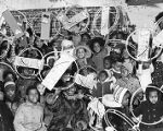 Group of children hold Christmas presents