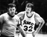 Philadelphia Seventy-Sixer Billy Cunningham yells at a referee