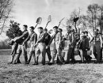 Boy scouts marching to plant trees