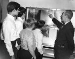 A hospital administrator explains x-rays to a group of boy scouts
