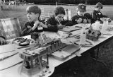 Boy scouts work at a craft table