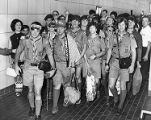 Boy scouts arrive from a trip to Japan