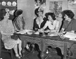 Women discuss the arrangements for a British War Relief benefit