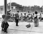 Actors perform on playground for children