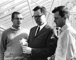 George Manaker and students checking flowers in the Ambler Campus greenhouse, 1966