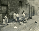 Children playing in Chicago alleyway