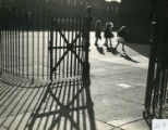 Girls playing in fenced in school yard