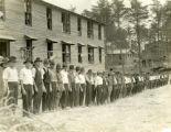 Men stand in line at Camp Meade in Maryland